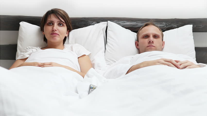 Wife And Husband On Bed