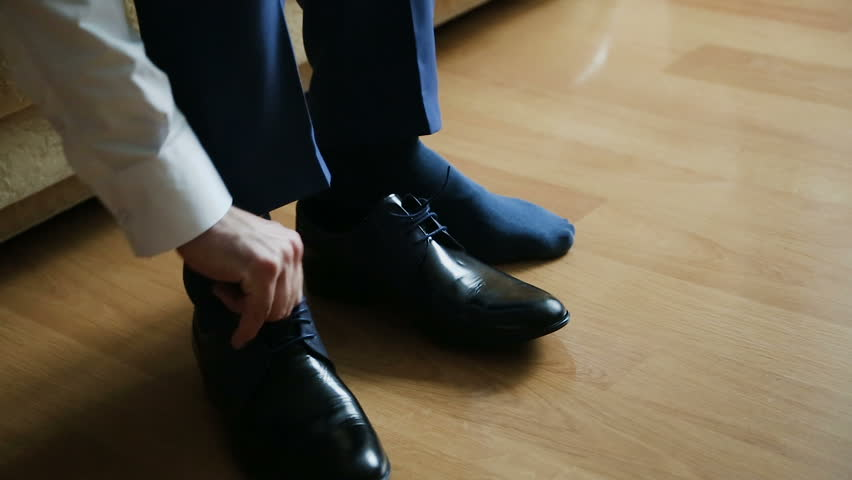 Man successfully ties his dress shoes