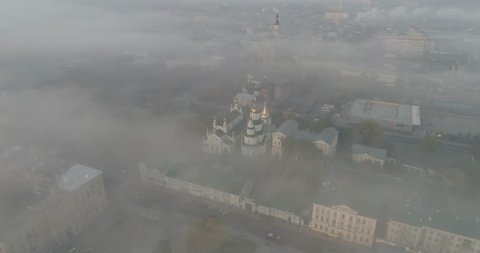 Morning fog above city center of Kharkiv, Ukraine.Shot of morning fog sitting on city center of Kharkiv, Ukraine. Main sights in shot are Pokrovski monastery in front and Annunciation Cathedral behind