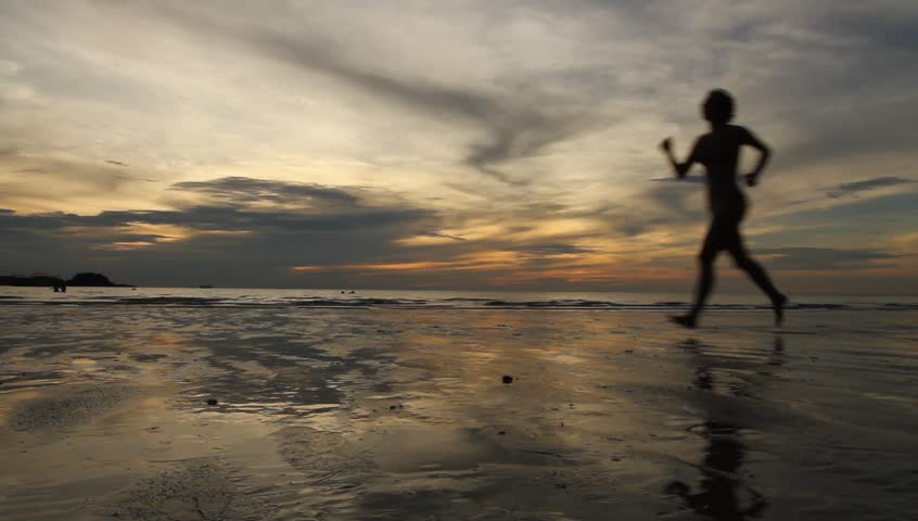 Silhouette running woman jogging at evening beach #3282701