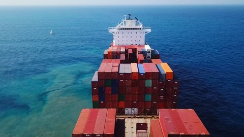 Mediterranean sea - November 15, 2017: Large ZIM container ship at sea, loaded with various container brands - Aerial footage