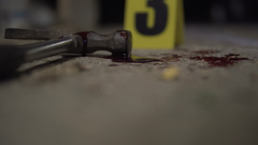 Hammer bloody murder weapon detail. Part of a crime scene site at night collection. Forensic  police scientists working, looking for clues and evidence. Blood splatter analysis. In 4K, interior.