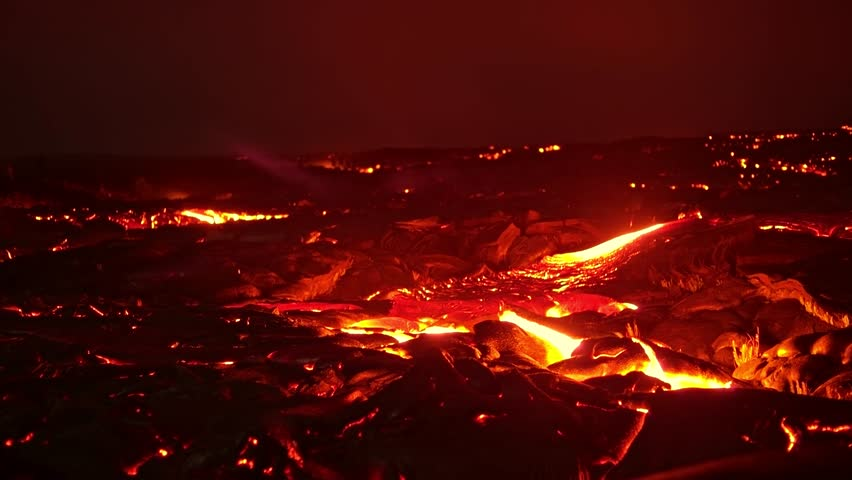 Lava rocks lift time lapse Night Glowing Hot flow from Kilauea Active Volcano Puu Oo Vent Active Volcano Magma