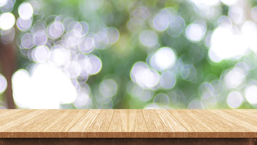 Empty wood table top with blur green tree at park bokeh light background,Backdrop template for display of product or design,food stand mock up | Shutterstock HD Video #32915467