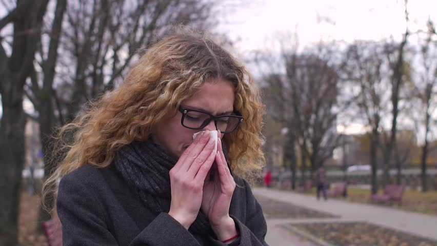 Sick woman blowing nose in cold weather, slow motion | Shutterstock HD Video #32925451