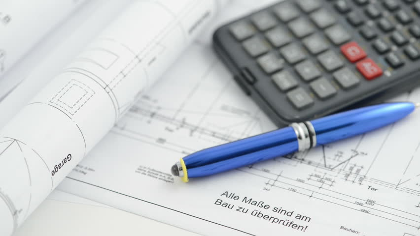 Pricing an architectural drawing blueprint with dividers and pricing an architectural drawing blueprint with dividers and calculator racking focus stock footage video 3293591 shutterstock malvernweather Gallery