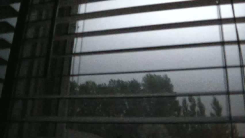 Lightning strikes abundantly through white window blinds in darkened room during summer night. #3293864