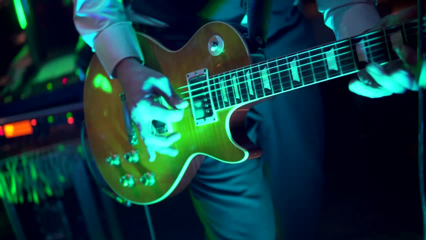 Lead Guitarist Live in a Band, Professional Guitar Playing Impressive Fast Solo. Performing at a Gig 4K | Shutterstock HD Video #32948701