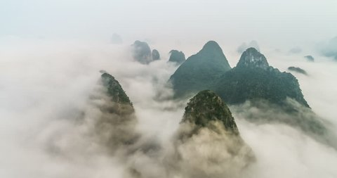 time lapse of aerial view of Karst mountains with beautiful cloudscape. Located near The Ancient Town of Xingping, Yangshuo County, Guilin City, Guangxi Province, China.