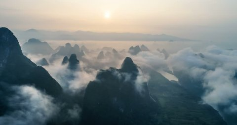 time lapse of aerial view of Karst mountains and beautiful cloudscape at sunrise. Located near The Ancient Town of Xingping, Yangshuo County, Guilin City, Guangxi Province, China.