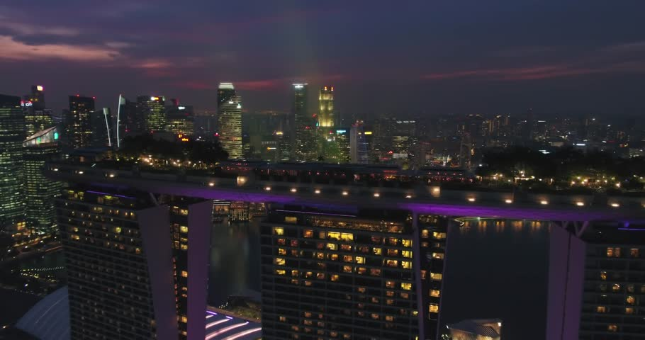 Aerial panning shot of Singapore city skyline at dusk (magic hour drone shot) - Singapore 2017 | Shutterstock HD Video #33000061