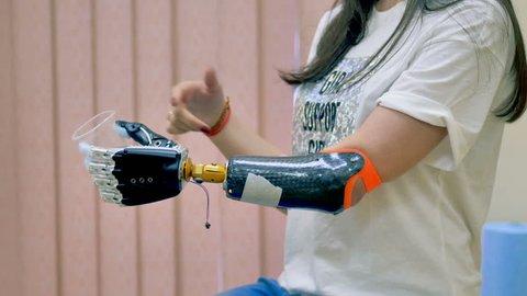 Human uses innovative robotic bionic arm. 4K.