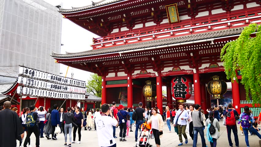 TOKYO JAPAN APRIL 16 , 2017 : Travel video Many tourists come to Sensoji temple tourists take photos and enjoy the beauty of the temple | Shutterstock HD Video #33005911