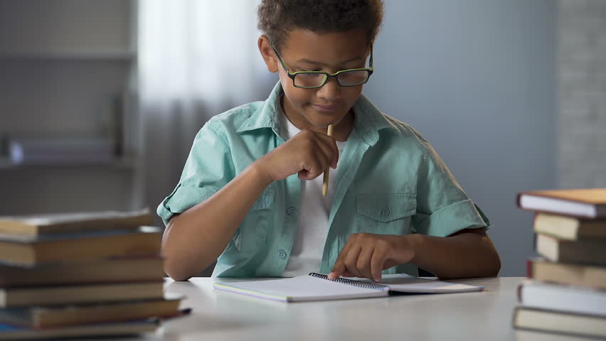 Boy with disability to learn reading and writing skills trying to concentrate | Shutterstock HD Video #33018988