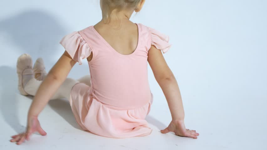 A small ballerina dances with enthusiasm. The girl is engaged in ballet