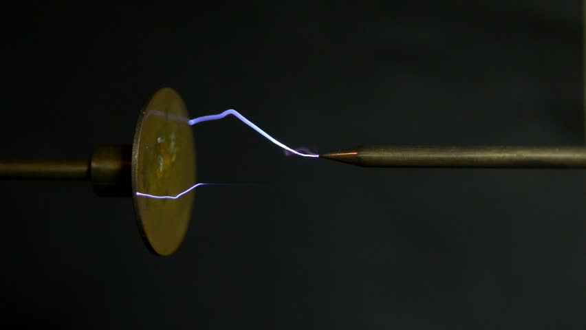 subdued lighting sparks in the spark gap of an induction apparatus scene is seen subdued subdued lighting footage stock clips