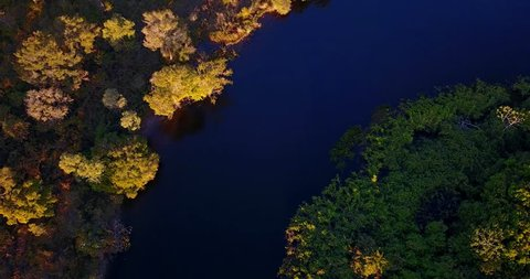 Boats sails in the river curve. Aerial image in the Pantanal Biome. Vegetation of Native forest.. Top view. Mato Grosso do Sul state, Central-Western Brazil.