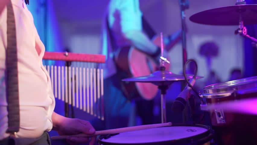 Drummer plays the melody on the drums energetically. | Shutterstock HD Video #33071041