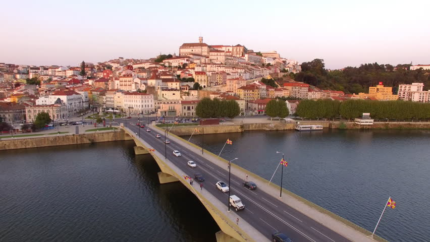 Coimbra, Portugal, aerial view of cityscape including the University of Coimbra and Mondego river at sunset.