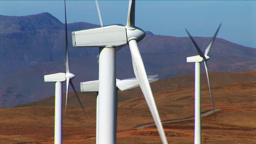 several wind turbines on mountain close up