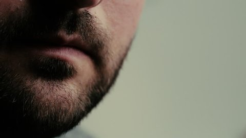 Vaping man close up, toned footage of vape device and person enhailing vape smoke or e-cigarette