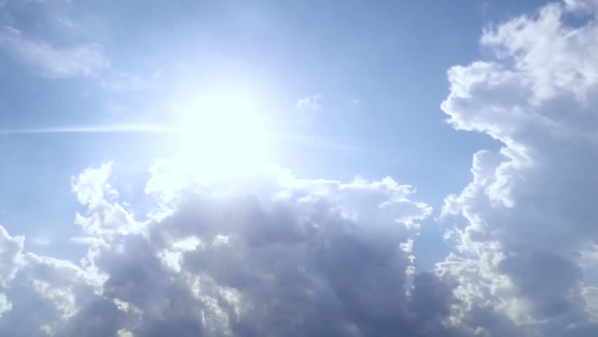 Sunrise clouds in blue skies. Beautiful cloudscape with large, building clouds and sunrise breaking through cloud mass. Time lapse of cloudscape with bright sun shining with clouds passing. FHD. 1080p