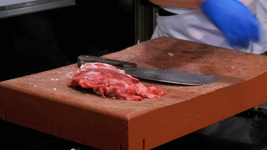 Butcher Man Hand Cutting Raw Meat With Knife. HD1080p ...