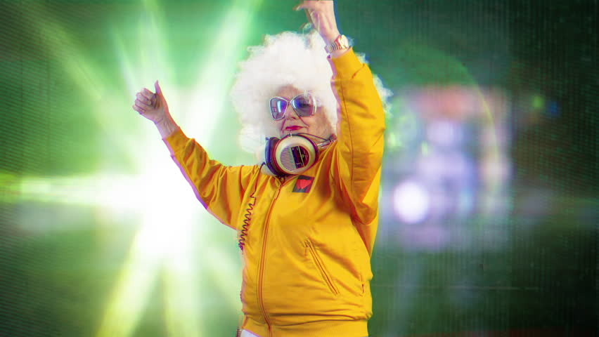 The most amazing grandma you will ever meet as a disco dancer, older lady partying in a hypnotic colourful disco setting | Shutterstock HD Video #33160981