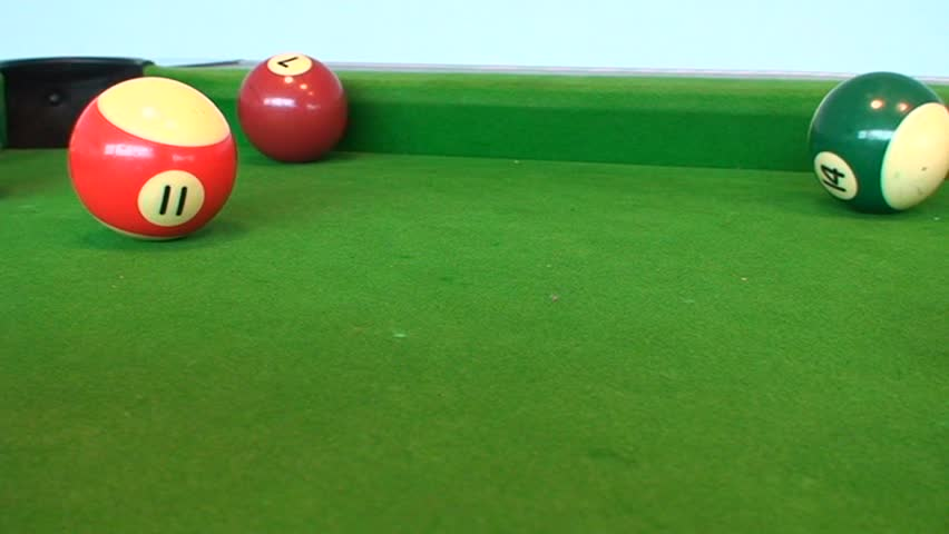 Tracking shot of pool table