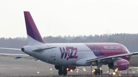 EINDHOVEN, THE NETHERLANDS- NOVEMBER 25th 2017: Wizzair passenger plane is taxiing to the runway for taking off.
