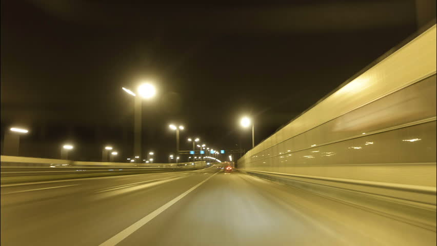 Time lapse of driving a car in the city at night time. POV. Hyper laps in the evening downtown. | Shutterstock HD Video #33174961