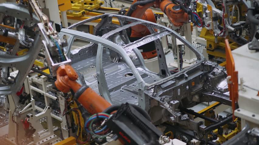 BELARUS, BORISOV - OCTOBER 19, 2017: Automobile plant, modern production of cars, car body assembly process, view of automated production line, October 19 in Borisov, Belarus.