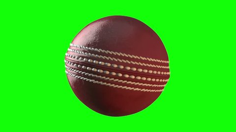 A loop able animation of a red cricket ball spinning in slow motion on a green screen background