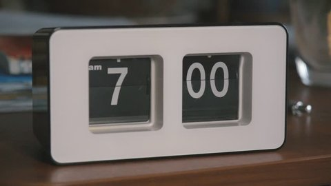 Flip clock mechanism. 7-00 AM. Super slow motion 240 fps