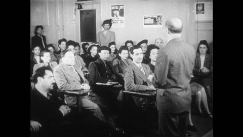 1940s: Man stands before large group of people seated in classroom. Paper with federal law. Animated arrows moving from western world to map of United States. Illustrated brick walls appear on map.