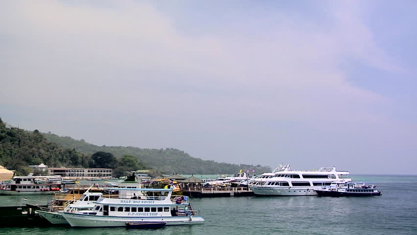 PHI PHI ISLAND, THAILAND - CIRCA FEBRUARY 2009: Ferries at the Ferry Terminal at Ao Loh Da Lam
