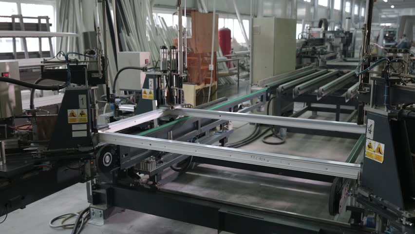 Kyiv, Ukraine - June, 2017: Automatic line machine for sticking together PVC sections of windows and doors in a single frame.    Shutterstock HD Video #33252421