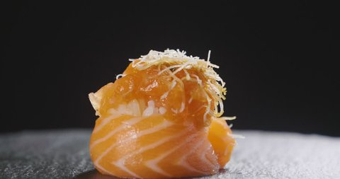 Macro shot of gourmet sushi, sashimi, uramaki and nighiri. typical Japanese dish consisting of rice, salmon or tuna,shrimp and fish eggs soaked in soy. Concept: Japanese restaurant, sushi.
