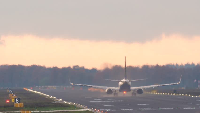 4k passenger airplane taking off from the runway.