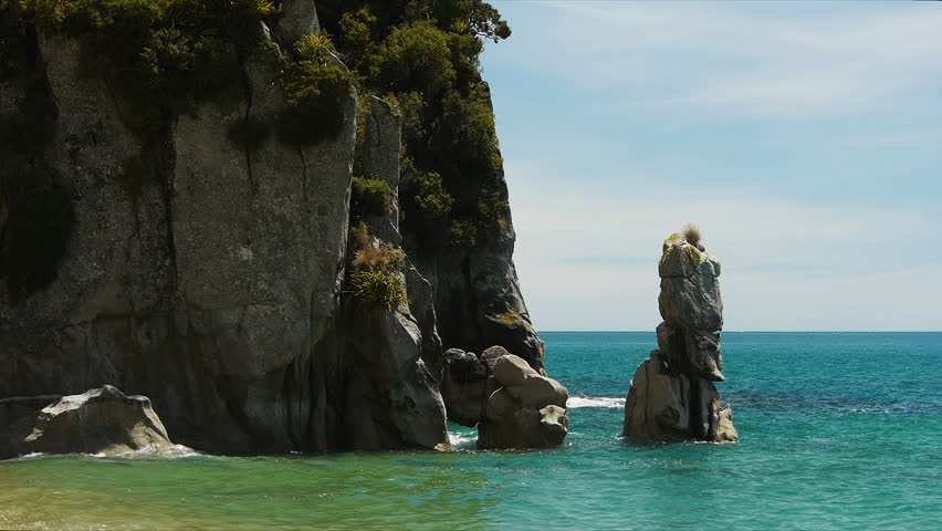 Close up shot of rock formations at anapai bay in the abel tasman national park in new zealand | Shutterstock HD Video #3327656