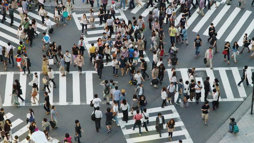 TOKYO, JAPAN - JUNE 30, 2012: Shoppers on a Cross Street Crossing in Shinjuku, Tokyo