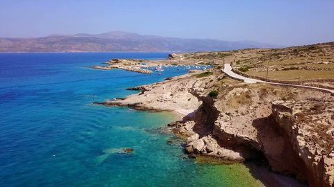 Aerial drone bird's eye video of famous rocky seascape of Koufonisi island with caves and turquoise - sapphire clear waters, Cyclades, Greece