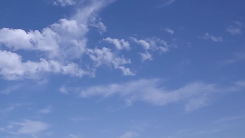 Time lapse clip of white fluffy clouds over blue sky, Puffy fluffy white clouds blue sky time lapse motion background. Bright blue sky puffy fluffy white cloud cloudscape cloudy heaven. Puffy fluffy.