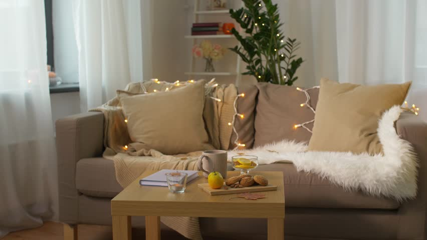 Beautifully Decorated Living Rooms. cozy home concept  book lemon cup of tea autumn leaves and oatmeal Luxury Apartment Interior View Of Beautifully Decorated Living