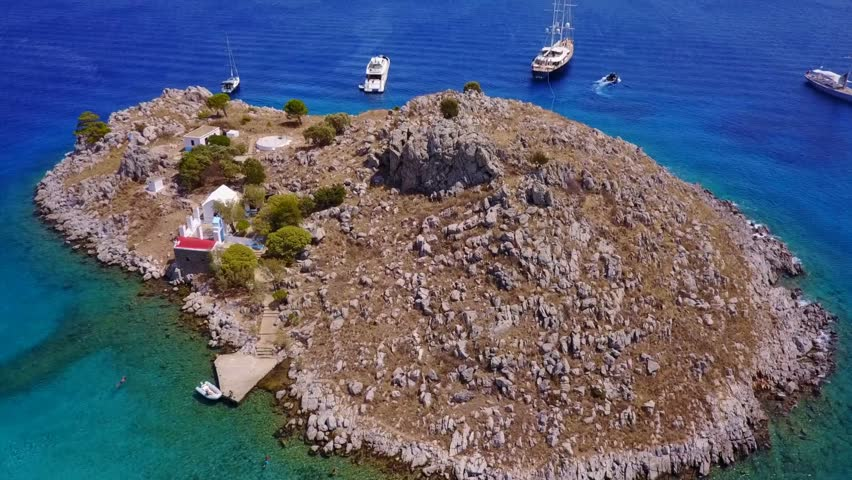 Aerial birds eye view video taken by drone of famous tropical beach of Agia Marina, Symi island, Dodecanese, Greece | Shutterstock HD Video #33349381