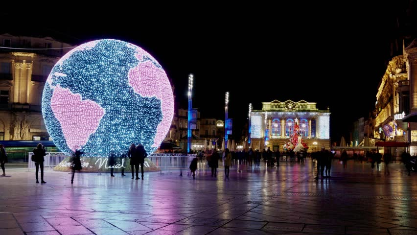 Time lapse on huge illuminated world map for Christmas decorations on the square of the city of Montpellier
