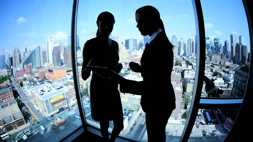 Silhouette successful multi ethnic female business team using touch screen technology in modern city workplace | Shutterstock HD Video #3336881