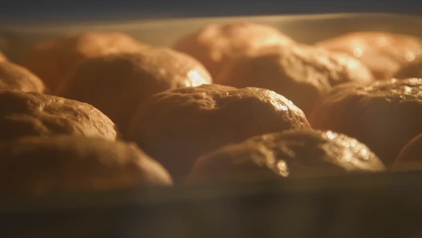 Baking bread in bakery oven with high temperature at kitchen. time lapse shot | Shutterstock HD Video #33393511