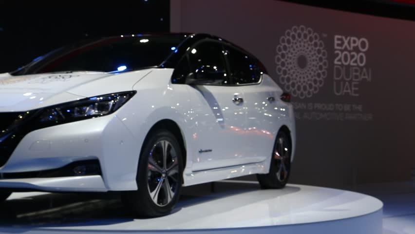 DUBAI, UAE - November 14: Nissan Leaf 2018 electric zero emission car unveiling ceremony during Dubai Int'l Motor Show 2017 at Dubai Int'l Convention and Exhibition Centre. | Shutterstock HD Video #33405931