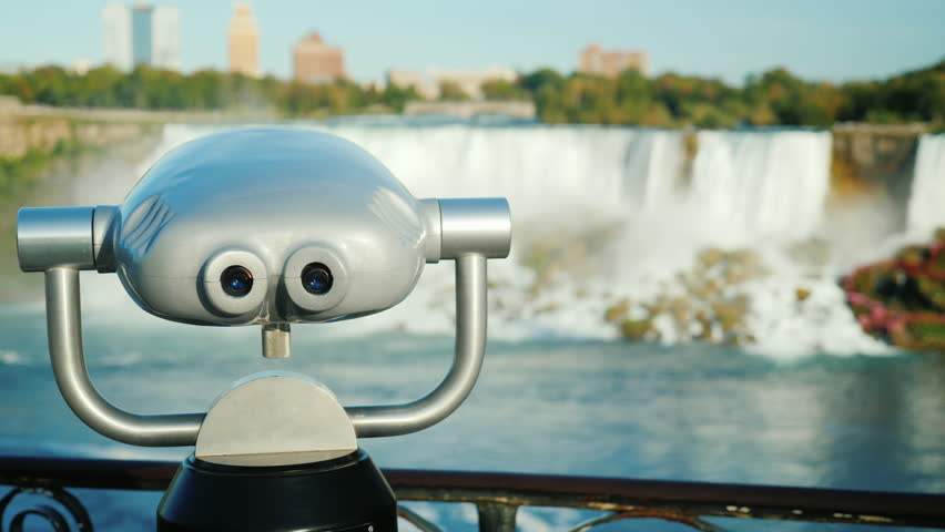 Coin operated binoculars overlooking the Niagara Falls - 4K stock footage clip